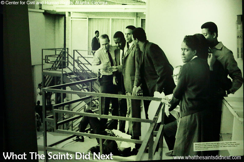 Memphis police officers and civil rights leaders Ralph Abernathy (second from left), Andrew Young (third from left), and Jesse Jackson (fourth from left) stand over the body of Dr Martin Luther King Jr after he was shot at the Lorraine Motel in Memphis, Tennessee, on April 4, 1968. (photograph displayed in Center for Civil and Human Rights, Atlanta, Georgia)