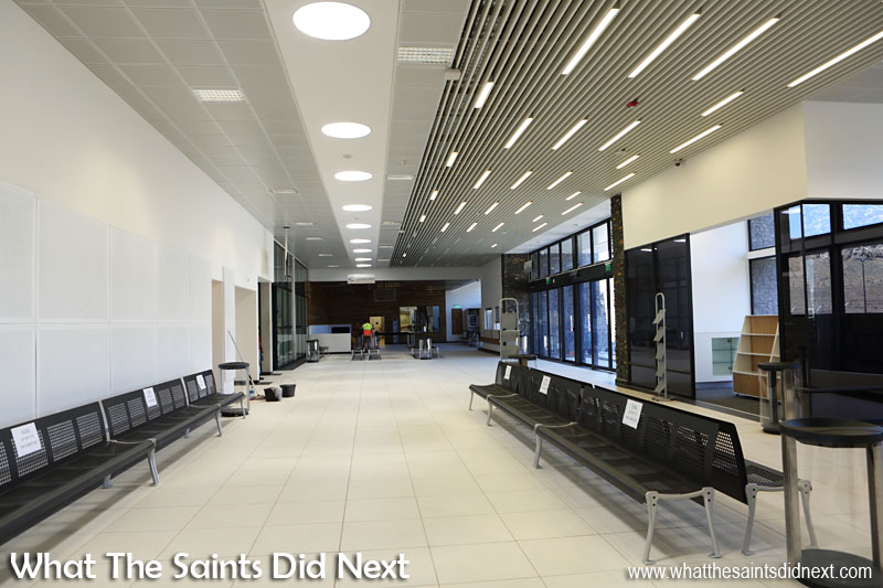 The concourse inside the St Helena Airport terminal on Prosperous Bay Plain. Note the circular sunlight funnels overhead feeding natural light into the building.