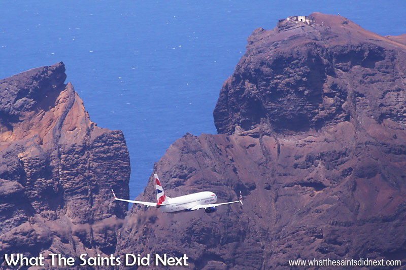 The Comair operated, British Airways Boeing 737-800 flying in for a first low-level pass over the new St Helena Airport, below the ruin of Prosperous Bay House and King & Queen Rock.