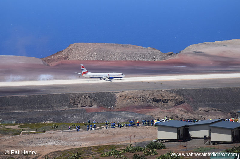 Touchdown at 12:08 for the Comair operated, British Airways Boeing 737-800, the first of its size and type to land at St Helena Airport. Viewed from near the Millennium Forest with spectators at Bradley's Camp visible in the foreground. Photo courtesy of Pat Henry.