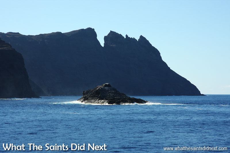 16 Pictures Celebrating St Helena Day 2016. George Island in the bay of Sharks Valley, with the backdrop of King & Queen Rock and Prosperous Bay Plain House in the far distance. A good example here of St Helena's rugged coastline.