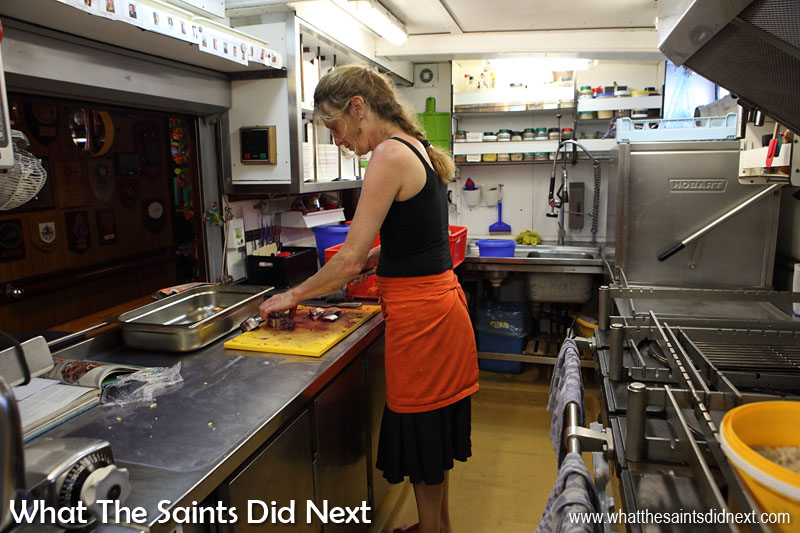 Marianne preparing dinner in the galley on board Bark Europa. Tonight it's fish on the menu.