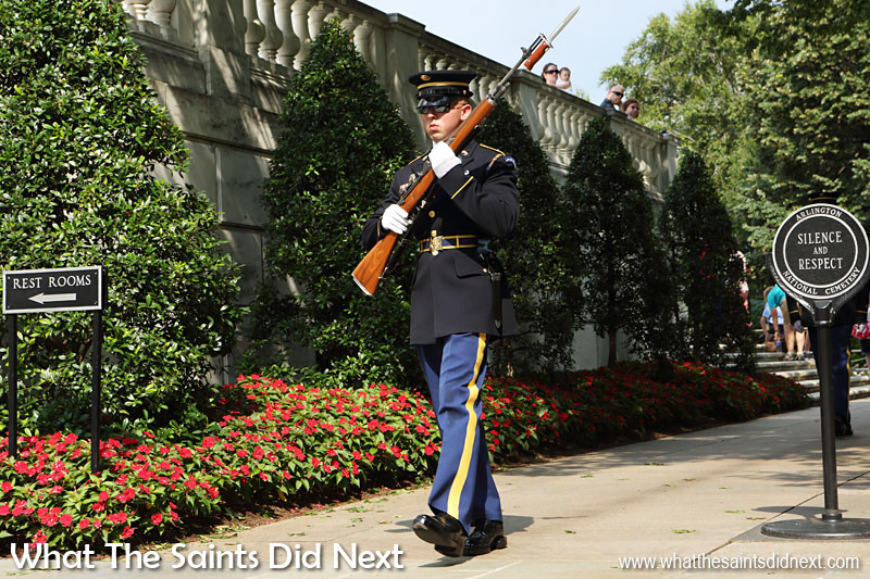The guard here has just been relieved of his sentry duty at The Tomb of the Unknown Soldier and is on his way to have a half hour break, no doubt glad to get out of the summer sun. Tomb of the Unknown Soldier is one of Arlington Cemetery's most well-known memorials.