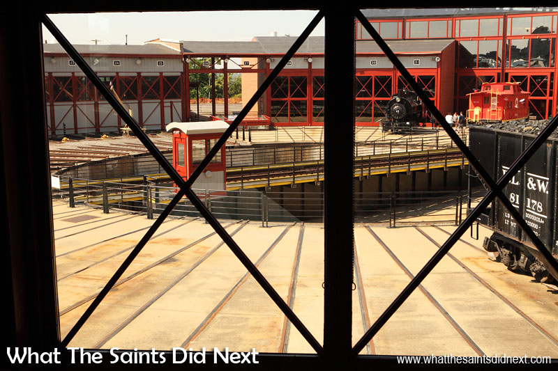 A wide angled view of the train turntable from inside the roundhouse building that has been reconstructed from remnants of a 1932 structure. Steamtown museum, Scranton.