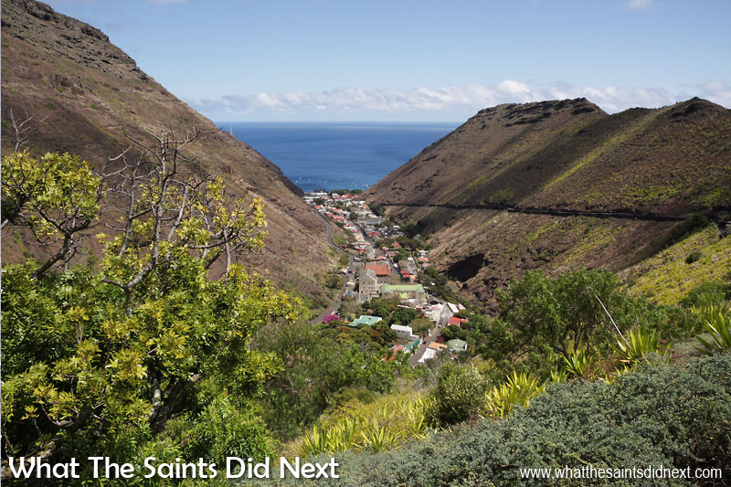 Jamestown, the capital of St Helena Island. Two of the main roads out of Jamestown can be seen here; the dark shape of Side Path Road running along the hillside on the right and the start of Ladder Hill Road heading up the hillside to the left.