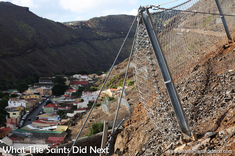 Heavy duty steel netting now offer some protection from rock rolls in Jamestown. There are catchment fences like these further up the valley and huge nets that cover the cliffs around the lower wharf area.