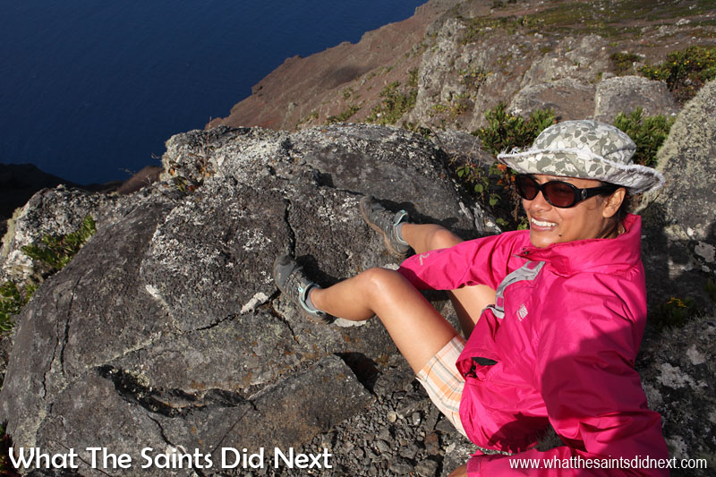 Sharon, sitting on top of the Barn, looking down over the seaward side. This was the day we reached the summit for the first time so we took our time to enjoy the fabulous views of St Helena from here.