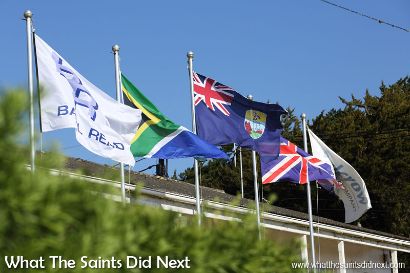 Flags flying outside offices of airport construction contractors, Basil Read, at their headquarters in Longwood. (l-r) Basil Read, South Africa, St Helena, Great Britain, Halcrow.