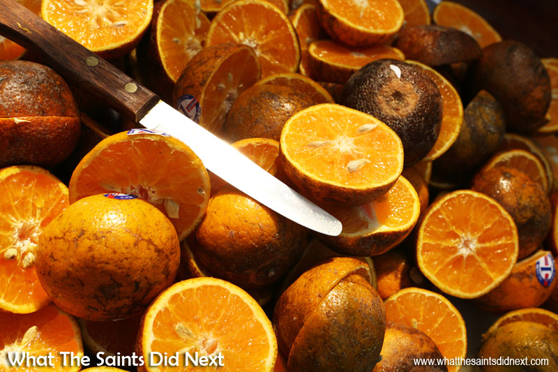 A street vendor in Thailand selling freshly squeezed orange juice had his fruit already cut in half and ready for thirsty customers. The rich colour was too tempting in the midday sun and the knife blade added the perfect constrast and focus to the shot. The trick here was to frame tightly so the oranges dominated the picture. Colour photography tips.