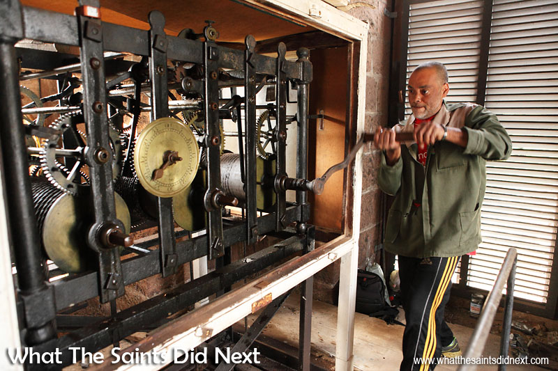 Roddy Yon winding the St James clock which was made in 1786 by Aynsworth Twaites of Clerkenwell. It was placed in St James in 1787 having been provided by the East India Company. Roddy climbs the tower twice a week to keep the clock working.