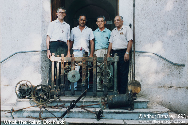 St James's Clock was removed for repairs in 1993 and was re-installed fully operational in 1995. The clock had not been working for approximately 15-20 years prior to this. Pictured here with Bishop Ruston (left) in 1993 are the three local craftsman who voluntarily undertook the repair work, from right: Arthur Bizaare, Geoffrey Scipio and Douglas Yon (Roddy's dad). St James Church clock tower, Jamestown, St Helena.