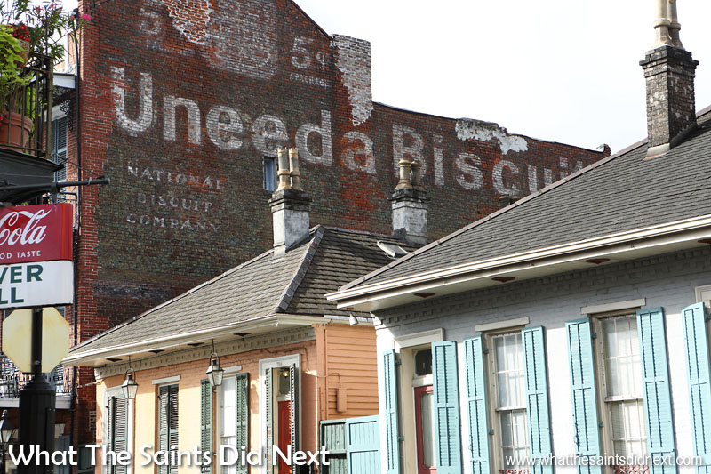 """Uneeda Biscuits 5c a packet.  National biscuit company [Nabisco].   French Quarter, New Orleans. We spotted this classic ghost sign whilst immersing ourselves in the magic of the Big Easy.   The story goes, when looking to package this new biscuit in 1898 the manufacturer said, """"You need a name,"""" and hence """"Uneeda"""" was born; a light, flaky cracker.  Nabisco operates still today and are the makers of Oreos and Ritz Crackers. They discontinued the Uneeda biscuit in 2009 after 111 years."""
