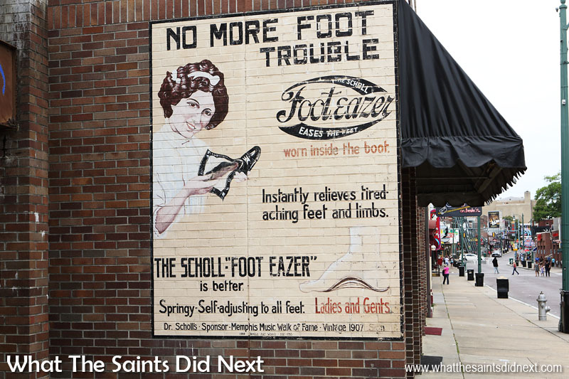 The Scholl Foot-Eazer.  No more foot trouble.   Beale Street, Memphis, Tennessee.  Authentic 1907 sign.   Out walking in Memphis we came across this beautiful ghost sign, promoting Scholl.  Dr William Scholl patented his first invention in 1907, a revolutionary foot insert to support the heel arch.  It was the start of his lifelong quest in foot care.  He died in 1968 leaving a company that still trades worldwide today.