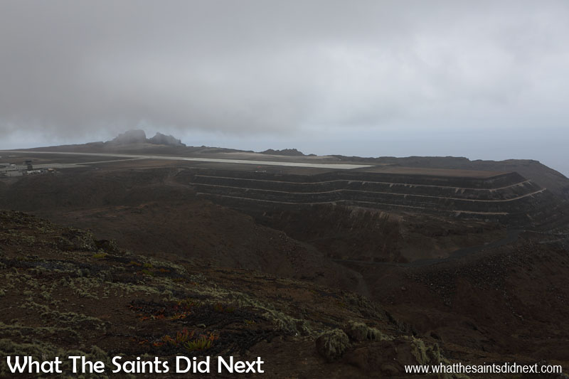 Embraer Trial Flight to St Helena. Not looking good one and half hours before the Embraer is due to arrive. Even in the gloom, this is a good view of the amazing fill job done in Dry Gut to create a foundation for the southern end of the runway.