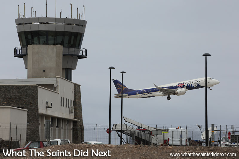 Embraer E190 St Helena Airport flight trials. Next stop, Brazil. The Embraer E190 departs St Helena after a successful two day visit, climbing into the sky in front of the airport control tower.