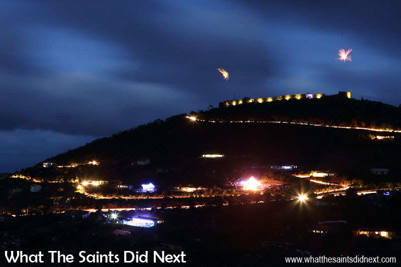 With many homes already decorated with Christmas lights, High Knoll was tonight a glittering sight complete with fireworks just to make sure everyone looked up! This long exposure captures the road routes, traced here by the vehicle headlights. Lighting High Knoll Fort, St Helena.