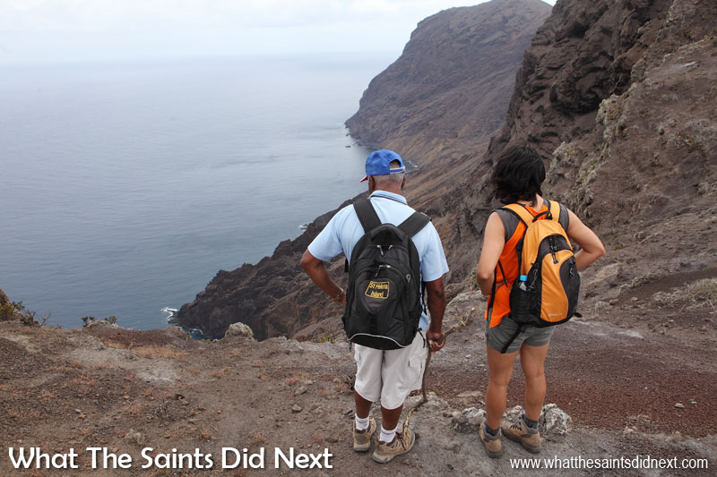 The fortress-like coastline of St Helena. Immediately below us is Flagstaff Bay, off in the distance is The Barn.  Sugar Loaf Post Box walk, St Helena.