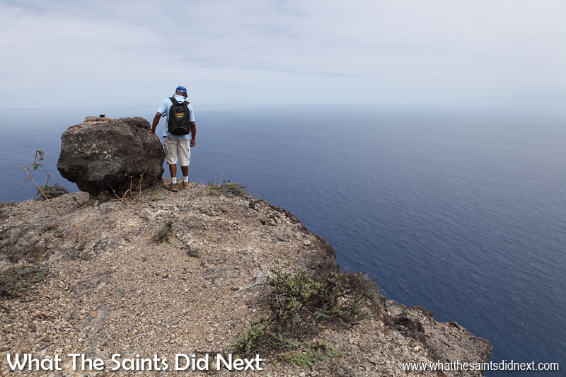 My dad, Pat, checks out the extreme view from the top of Sugar Loaf. Not for me. Sugar Loaf Post Box walk, St Helena.