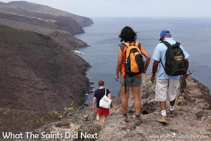 Beginning the descent off Sugar Loaf. Our destination now is Jamestown hidden in the valley, just in from where the little boats can be seen in the anchorage. The houses on the top of the hill is Half Tree Hollow. Sugar Loaf Post Box walk, St Helena.