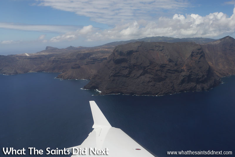 Minute 2 - a closer view of The Barn. The airport runway can be seen on the left. This is the Runway 20, northern approach which suffers from the dreaded wind shear up close to the cliffs. The pointed hill just to the right of the runway is Great Stone Top. Flying from St Helena Airport.