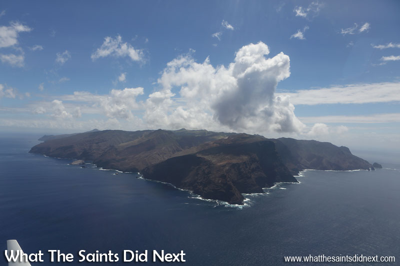 Minute 6 - Turning left around the jutting headland of South West Point and a great view of the entire island, showing just how small St Helena is. Along the coastline to the left the white coloured Egg Island can be seen. To the right is Manati Bay. Flying from St Helena Airport.