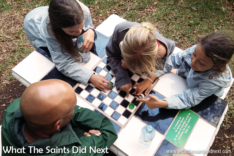 Things To Do With Kids On St Helena - This tile-topped table in Castle Gardens has a built in chess board which generated plenty of competition on a day out, even if the rules being followed at the time were a little suspect!